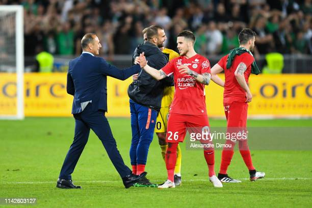 Michel Der Zakarian head coach of Montpellier celebrates the victory with Mihailo Ristic during the Ligue 1 match between Saint Etienne and...
