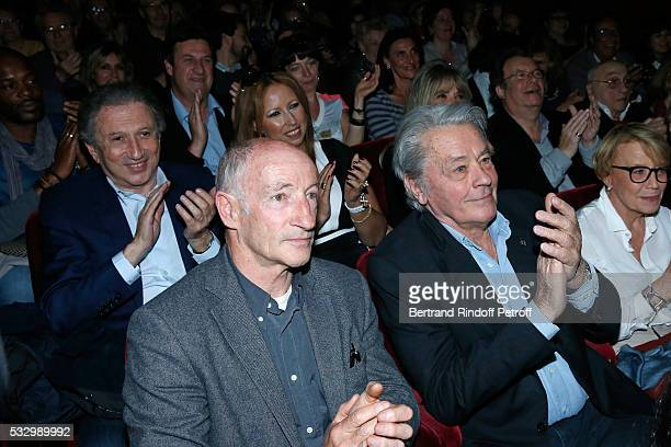 Michel Drucker and Alain Delon attend the 100th representation of the Theater piece 'Un nouveau depart' at Theatre Des Varietes on May 19 2016 in...
