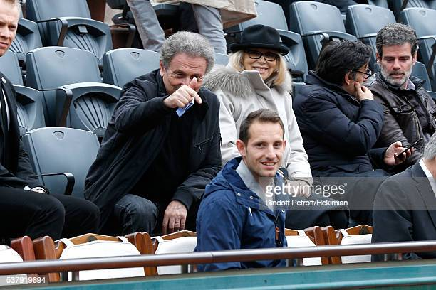 Michel Drucker Mireille Darc and Pole vault champion Renaud Lavillenie attend Day Thirteen of the 2016 French Tennis Open at Roland Garros on June 3...