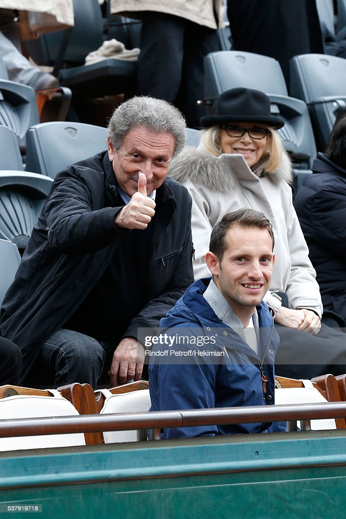 Michel Drucker, Mireille Darc and Pole vault champion Renaud Lavillenie attend Day Thirteen of the 2016 French Tennis Open at Roland Garros on June 3, 2016 in Paris, France.