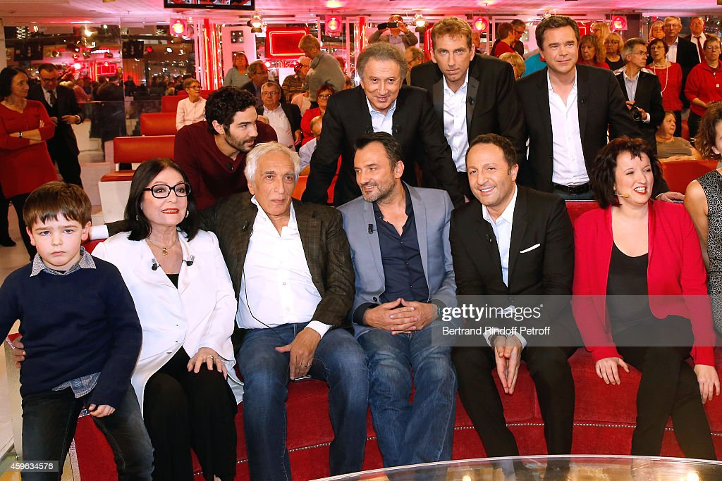 Michel Drucker, Thierry Garcia, Guillaume de Tonquedec, (Front L-R) Victor Cabale, Main guest of the show Nana Mouskouri, Gerard Darmon, Frederic Lopez, Arthur and Anne Roumanoff attend the 'Vivement Dimanche' French TV Show at Pavillon Gabriel on November 26, 2014 in Paris, France.