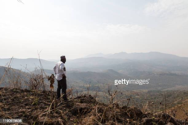 Michel Eclador Pekoua a former UPC official overlooks the mountains in Bandenkop that were bombarded with napalm by the French army in the 1950s in...