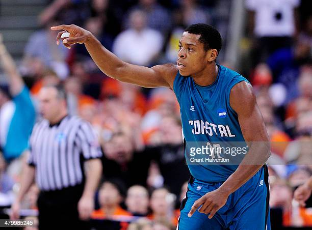 Michel Enanga of the Coastal Carolina Chanticleers reacts in the first half against the Virginia Cavaliers during the Second Round of the 2014 NCAA...