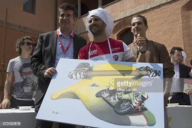 Michel Fabrizio of Italy and Althea Racing poses and celebrates the victory during the preevent 'Riders preparing a traditional handmade pasta in...