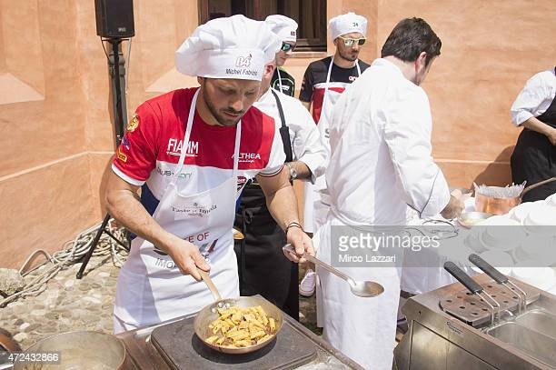 Michel Fabrizio of Italy and Althea Racing prepares pasta during the preevent 'Riders preparing a traditional handmade pasta in Ristorante San...