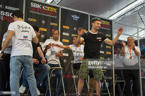 Michel Fabrizio of Italy and Red Devils Roma and Chantal greets the fans during the press conference 'SBK Fun Safe Corri in pista e non in strada' in...