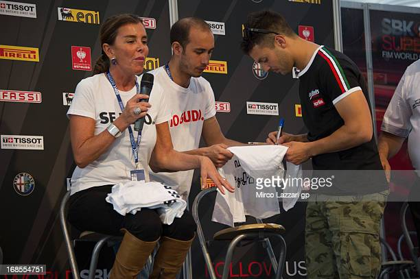 Michel Fabrizio of Italy and Red Devils Roma and Chantal signs autographs for fans during the press conference 'SBK Fun Safe Corri in pista e non in...