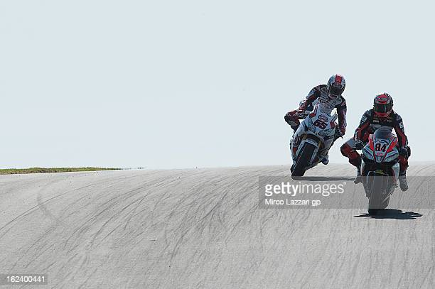 Michel Fabrizio of Italy and Red Devils Roma leads Jonathan Rea of Great Britain and Pata Honda World Superbike during the qualifying during the...