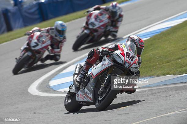 Michel Fabrizio of Italy and Red Devils Roma leads the field in Race 1 of the World Superbikes during round five of 2013 Superbikes FIM World...
