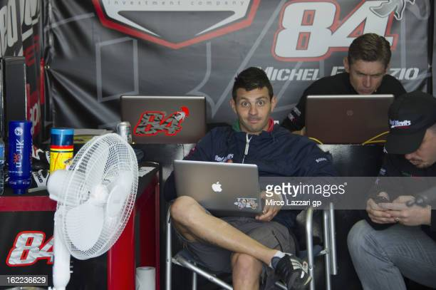 Michel Fabrizio of Italy and Red Devils Roma looks on in box during the round first of 2013 Superbike FIM World Championship at Phillip Island Grand...