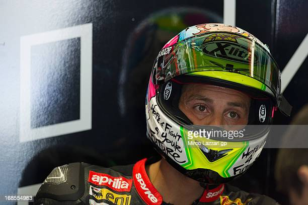 Michel Fabrizio of Italy and Red Devils Roma looks on in box during the World Superbikes Qualifying during the round four of 2013 Superbike FIM World...