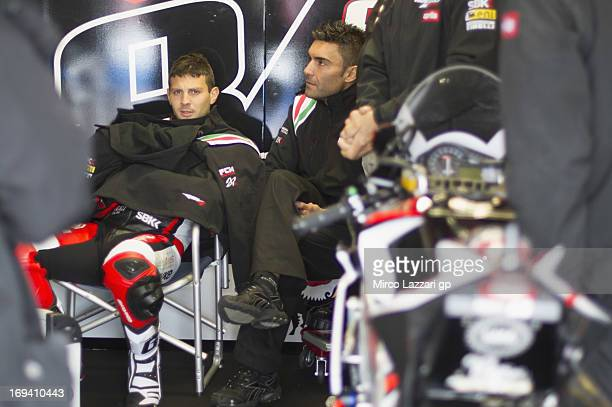 Michel Fabrizio of Italy and Red Devils Roma looks on in box during the World Superbikes Practice during the round five of 2013 Superbikes FIM World...