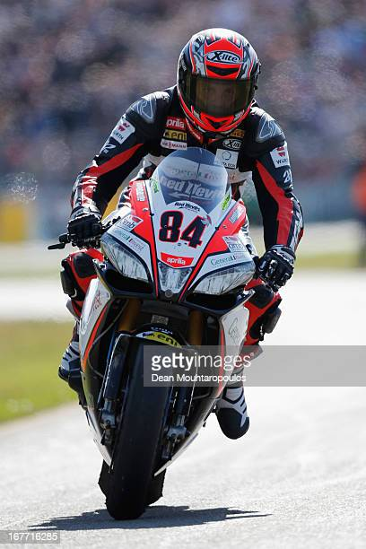 Michel Fabrizio of Italy on the Aprilia RSV4 Factory for Red Devils Roma enters the pitts after the World Superbikes Race 2 at TT Circuit Assen on...