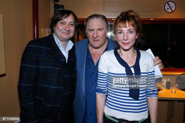 Michel Fau Gerard Depardieu and his daughter Julie Depardieu pose after 'Depardieu Chante Barbara' at Le Cirque d'Hiver on November 6 2017 in Paris...