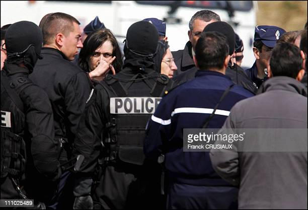 Michel Fourniret and Monique Olivier surrounded by RAID members in Chalons-en-Champagne, France on April 11st , 2006.