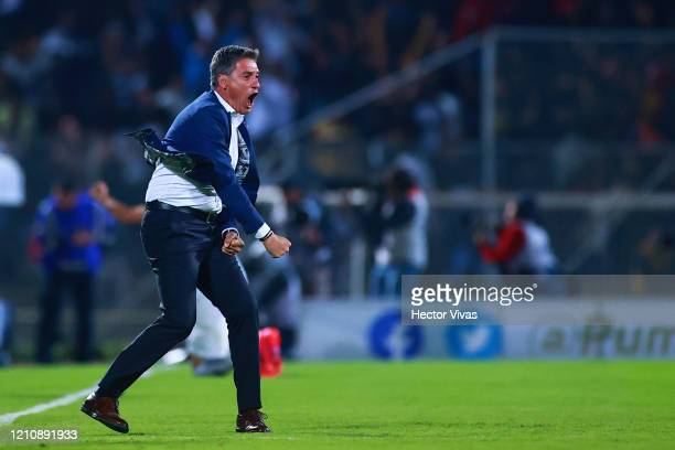 Michel Gonzalez head coach of Pumas UNAM celebrates the third goal of his team during the 9th round match between Pumas UNAM and America as part of...