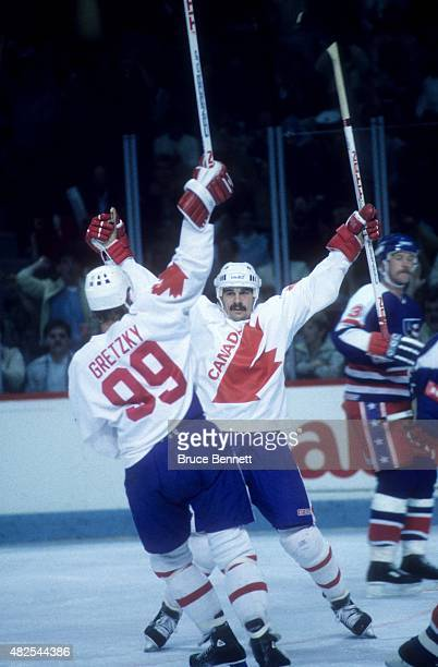 Michel Goulet and Wayne Gretzky of Team Canada celebrate a goal during the 1984 Canada Cup game against Team USA on September 3 1984 at the Montreal...