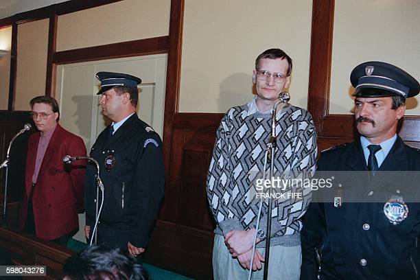 Michel Guillaume and Francis Heaulme accused of the rape and the murder of Laurence Guillaume a 14yearold girl look on during their trial at the Metz...