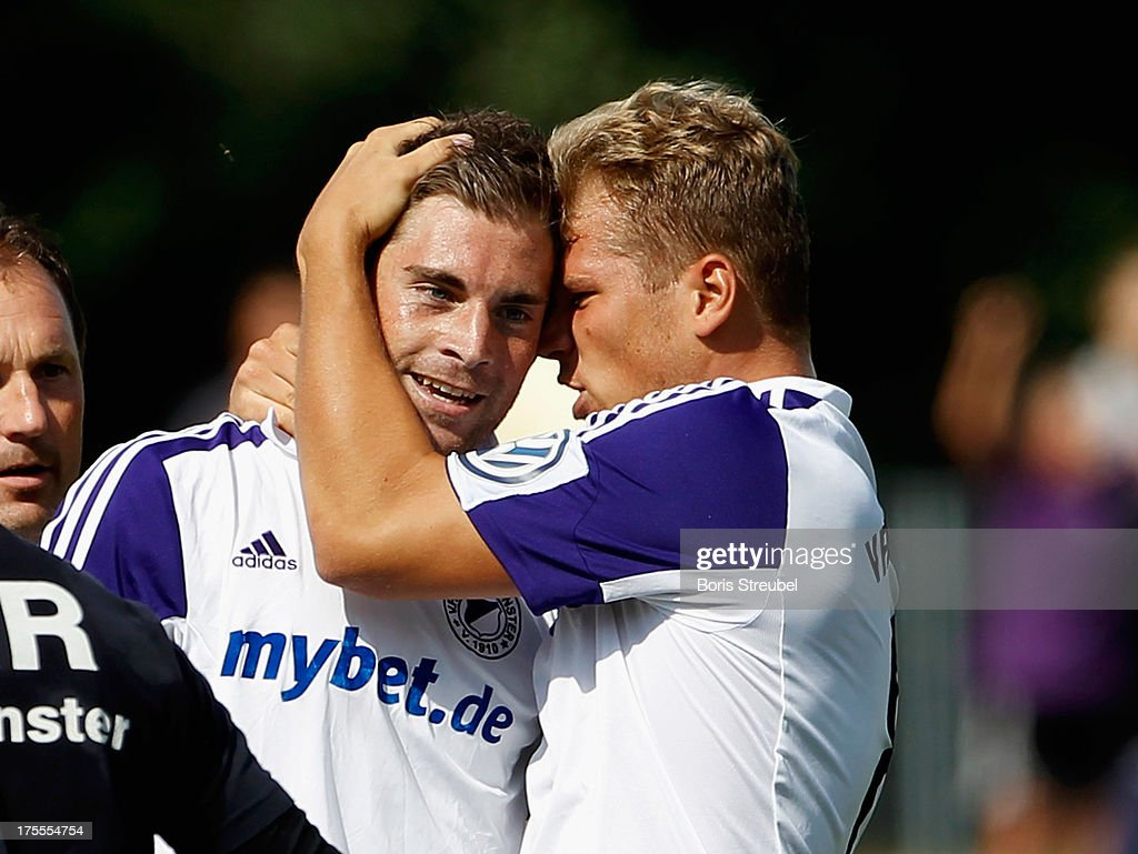 Michel Harrer (L) of Neumuenster celebrates his team's first goal with team mate Christopher Kramer during the DFB Cup first round match between VfR Neumuenster and Hertha BSC Berlin at Gruemmi-Arena on August 4, 2013 in Neumuenster, Germany.