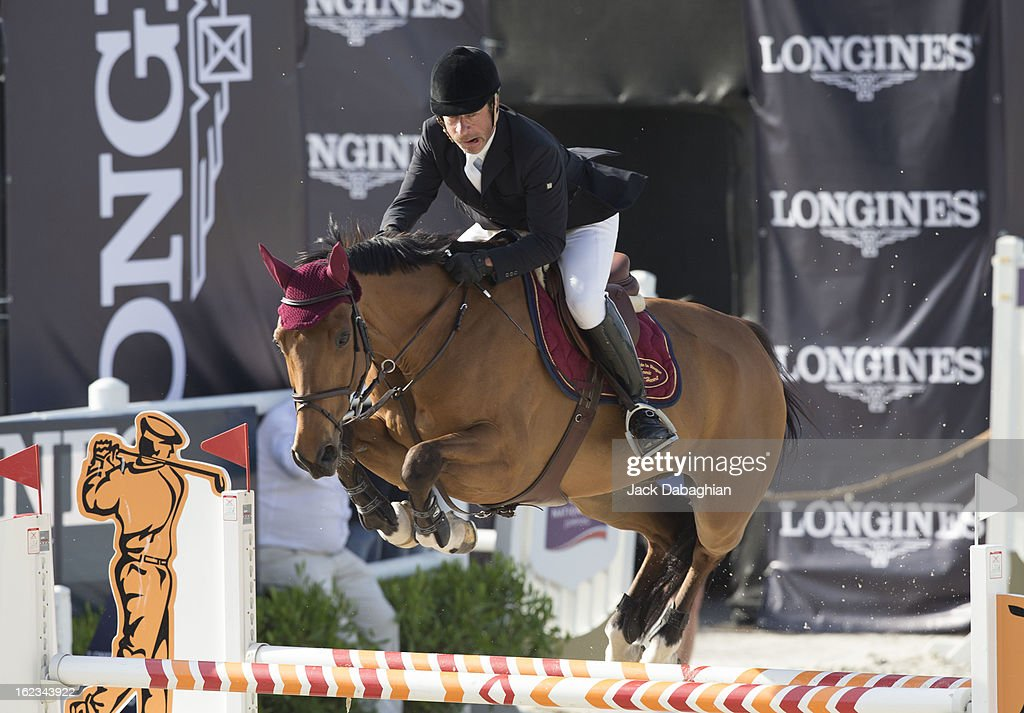 Michel Hecart of France clears a hurdle on Priman de Deviniere during the President of the UAE Showjumping Cup - Furusyiah Nations Cup Series presented by Longines on February 21, 2013 in Al Ain, United Arab Emirates.
