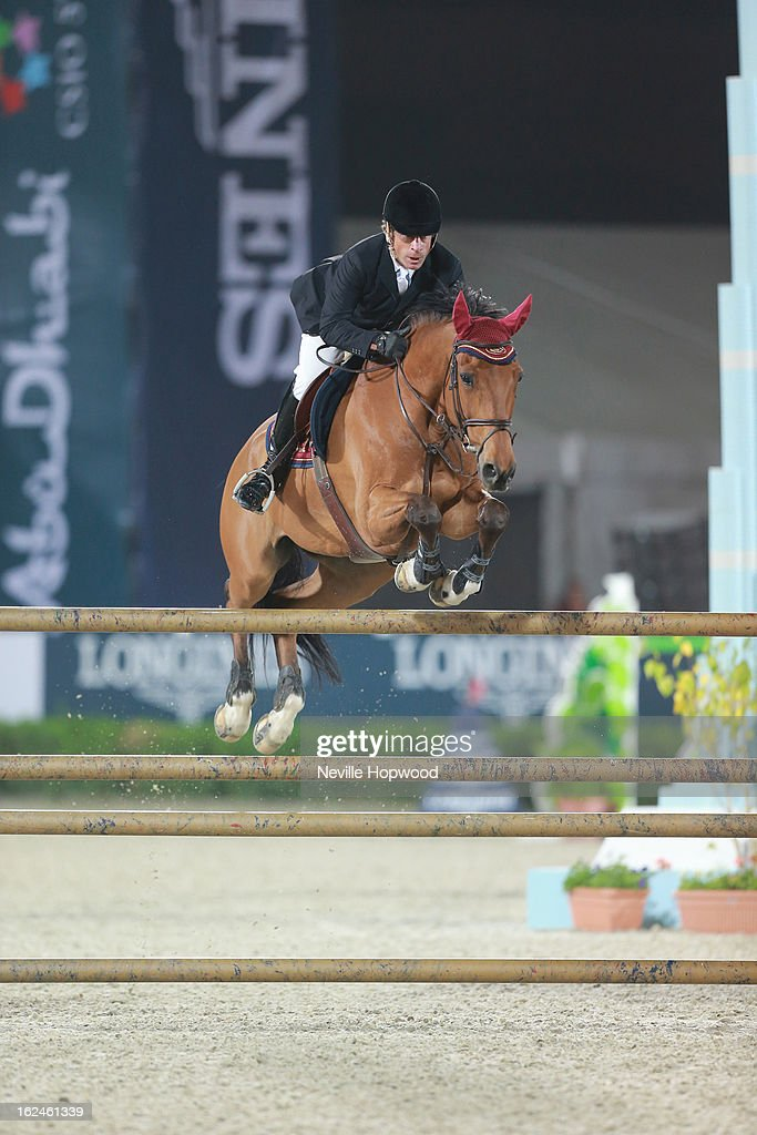 Michel Hecart of France rides Piman De Deviniere during the President of the UAE Showjumping Cup - Furusiyyah Nations Cup Series presented by Longines on February 23, 2013 in Al Ain, United Arab Emirates.