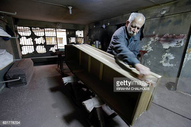 Michel Homsi the last craftsman building handmade coffins in the northern Lebanese city of Tripoli works at his shop on December 21 2016 Coffin maker...