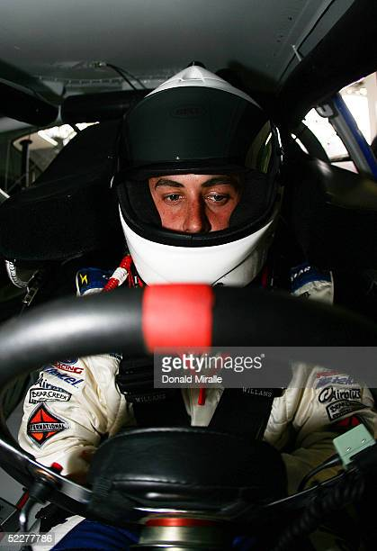Michel Joudain Jr. Of Mexico looks on from inside of his Telcel Ford Taurus during the practice for the Telcel Mexico 200 Nascar Busch Series Race at...