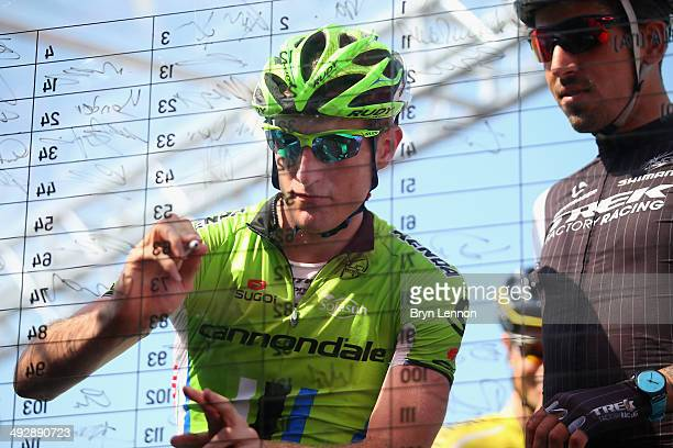 Michel Koch of Germany and Cannondale signs on ahead of the eleventh stage of the 2014 Giro d'Italia a 249km medium mountain stage between Collecchio...