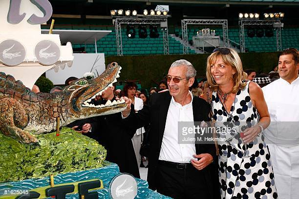 Michel Lacoste and Rejane Lacoste pose next to the birthay cake during the Lacoste 75 years celebration at Roland Garros on June 18 2008 in Paris...