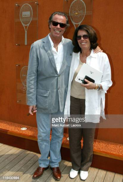 Michel Leeb and his wife Beatrice pose in the 'Village' the VIP area of the French Open at Roland Garros arena in Paris France on June 3 2007
