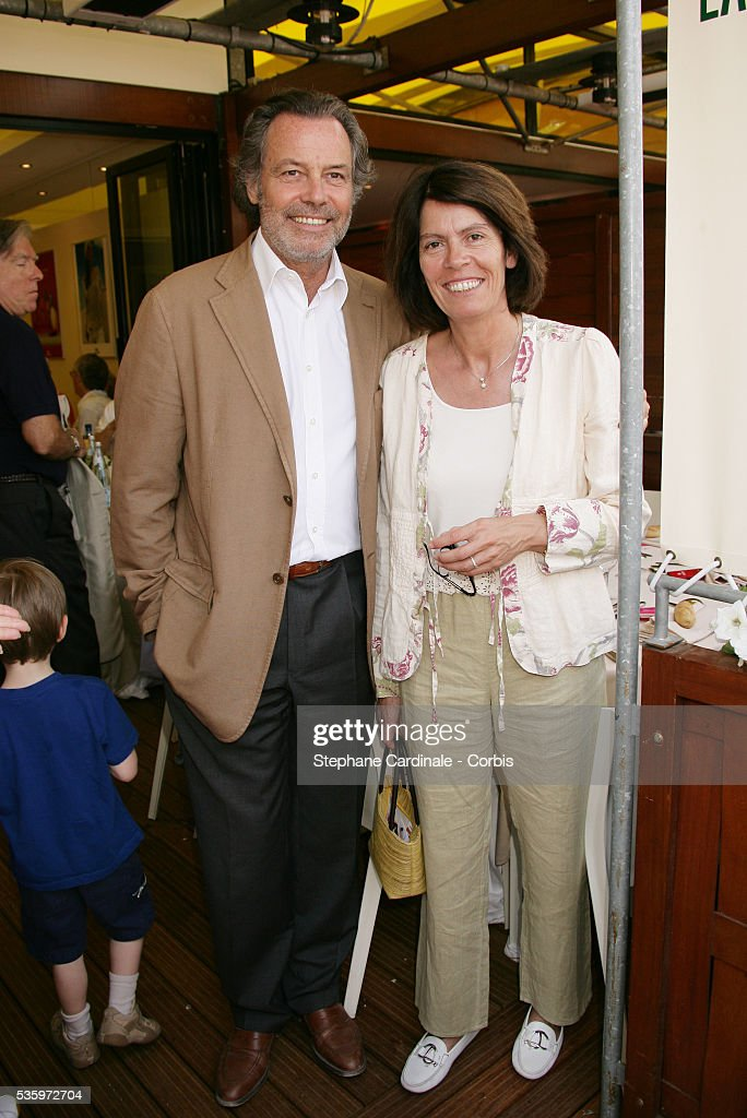 Michel Leeb and his wife visit Roland Garros village during the 2005 French Open tennis.
