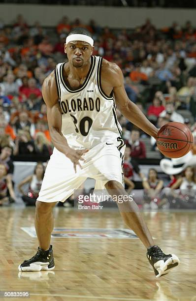 Michel Morandais of the Colorado Buffaloes moves the ball during the Phillips 66 Big 12 Tournament quarterfinals game against the Texas Tech Red...