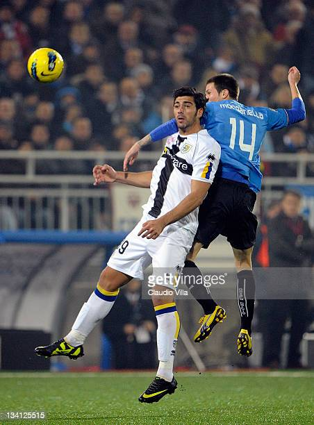 Michel Morganella of Novara Calcio and Graziano Pelle of Parma FC compete for the ball during the Serie A match between Novara Calcio and Parma FC at...