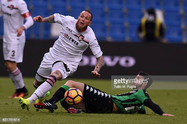 Michel Morganella of Palermo and Luca Mazzitelli of Sassuolo compete for the ball during the Serie A match between US Sassuolo and US Citta di...