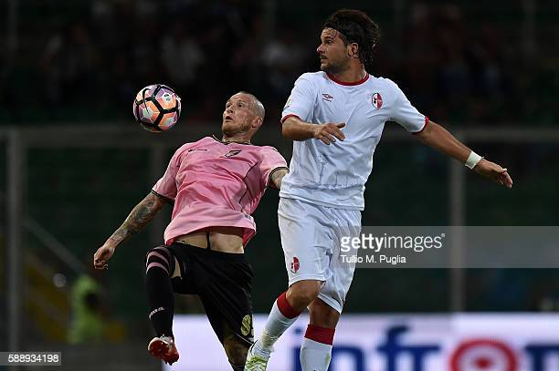 Michel Morganella of Palermo and Riccardo Maniero of Bari compete for the ball during the Coppa Italia Tim Cup match between US Citta' di Palermo and...