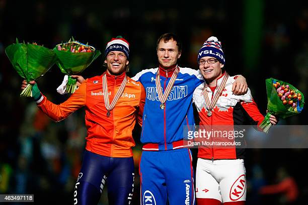 Michel Mulder of the Netherlands Pavel Kulizhnikov of Russia and Laurent Dubreuil of Canada pose on the podium with their medals for the mens 500m...