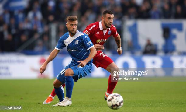Michel Niemeyer of Magdeburg and Borys Tashchy of Duisburg compete the Second Bundesliga match between 1 FC Magdeburg and MSV Duisburg at MDCC Arena...