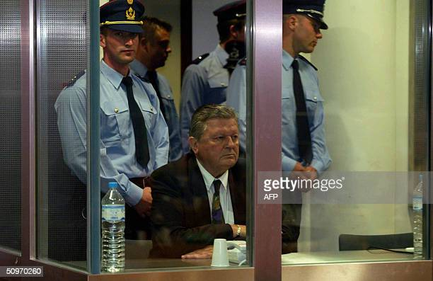 Michel Nihoul sits 17 June 2004 during the reading of the verdict at the Arlon courthouse Belgian paedophile Marc Dutroux was found guilty of...