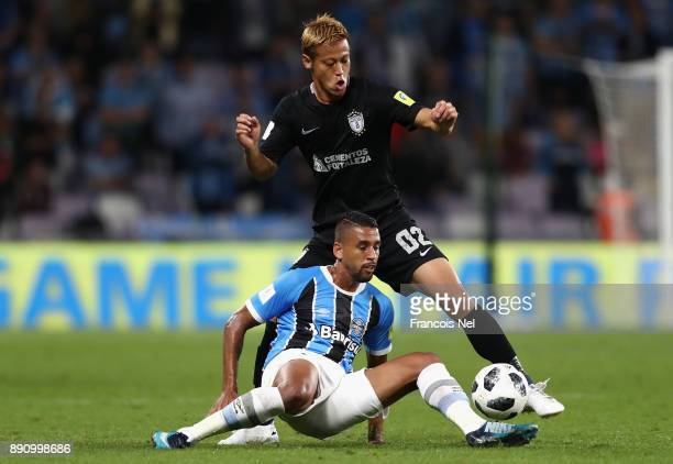 Michel of Gremio battles for possesion with Keisuke Honda of CF Pachuca during the FIFA Club World Cup UAE 2017 semifinal match between Gremio FBPA...