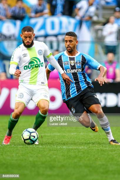 Michel of Gremio battles for the ball against Arthur Caike of Chapecoense during the match Gremio v Chapecoense as part of Brasileirao Series A 2017...