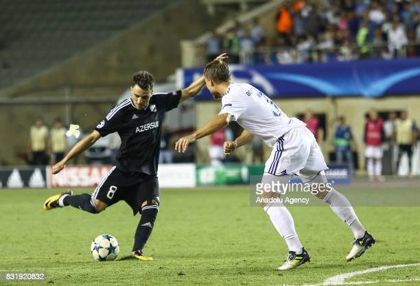 Michel of Qarabag Agdam in action against Pierre Bengtsson of FC Copenhagen during the UEFA Champions League playoff match between Qarabag Agdam and...