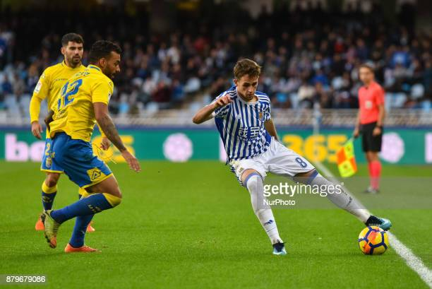 Michel of U D Las Palmas duels for the ball with Adnan Januzaj of Real Sociedad during the Spanish league football match between Real Sociedad and U...