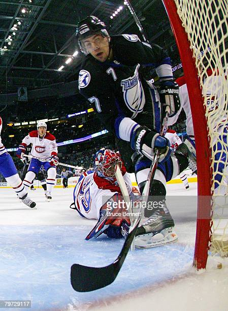 Michel Ouellet of the Tampa Bay Lightning scores a first period goal past Cristobal Huet and defenseman Josh Gorges of the Montreal Canadiens at the...