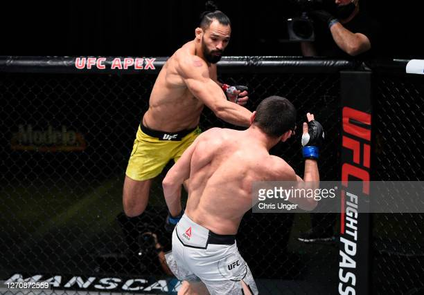 Michel Pereira of Brazil punches Zelim Imadaev of Russia in a welterweight fight during the UFC Fight Night event at UFC APEX on September 05, 2020...