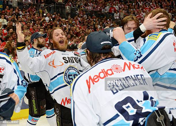 Michel Periard and Jean Francois Boucher celebrate the win after game seven of the DEL playoff final on April 29, 2014 in Cologne, Germany.