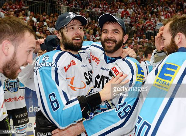 Michel Periard and Thomas Greilinger celebrate the win after game seven of the DEL playoff final on April 29 2014 in Cologne Germany