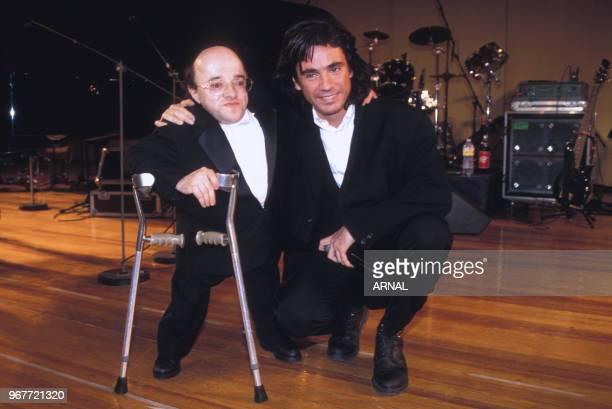 Michel Petrucciani et Jean-Michel Jarre lors d'une soirée le 15 décembre 1994 à Paris, France.