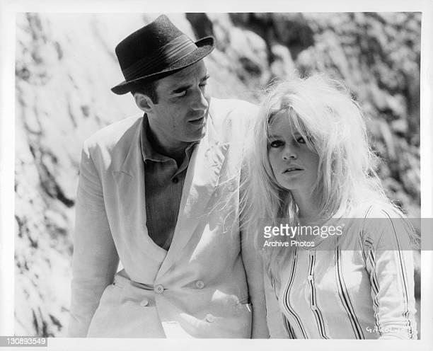 Michel Piccoli looking at Brigitte Bardot in a scene from the film 'Contempt', 1963.