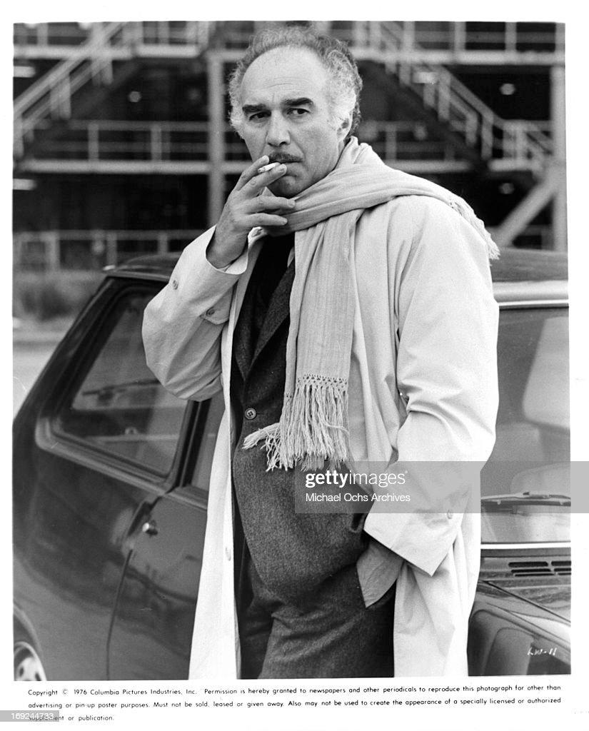 Michel Piccoli takes a smoke break in a scene from the film 'The Last Woman
