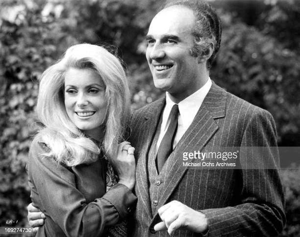 Michel Piccoli with his arm around Catherine Deneuve in scene from the film 'Heartbeat' 1968